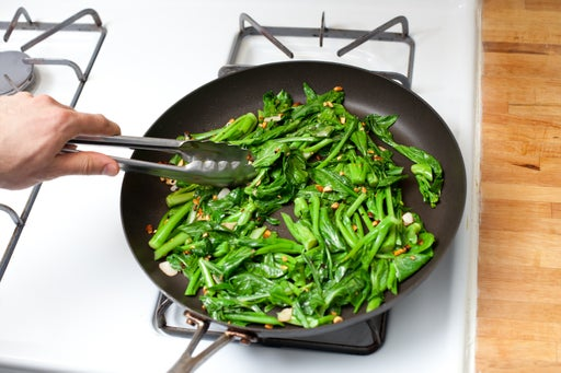 Stir-fry the yu choy: