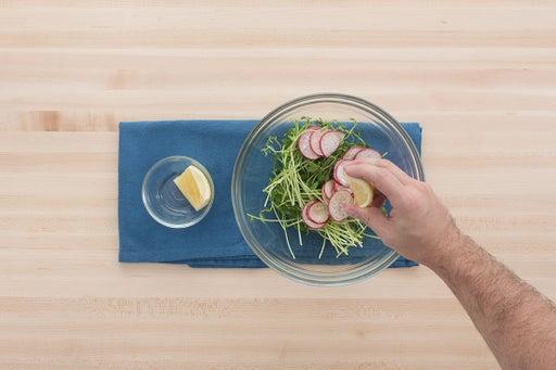 Dress the pea shoots & serve your dish: