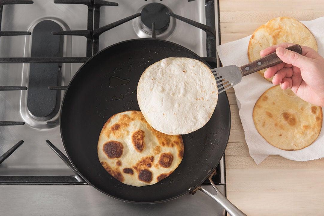 Toast the tortillas: