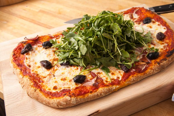Whole Wheat Pizza Topped with Arugula Salad