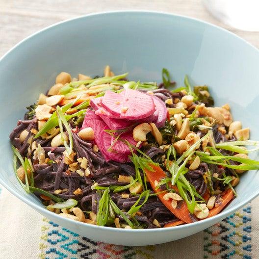 Spicy Black Rice Noodles with Daikon Radish, Garlic Peanuts & Broccolini