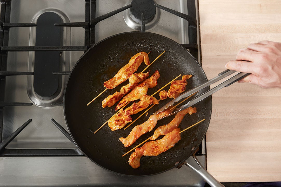 Cook the chicken skewers: