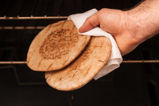 Toast the pitas: