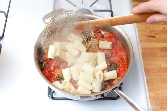 Boil the pasta & add it to the sauce: