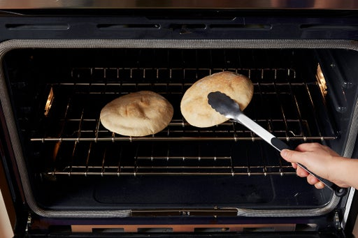 Warm the pitas: