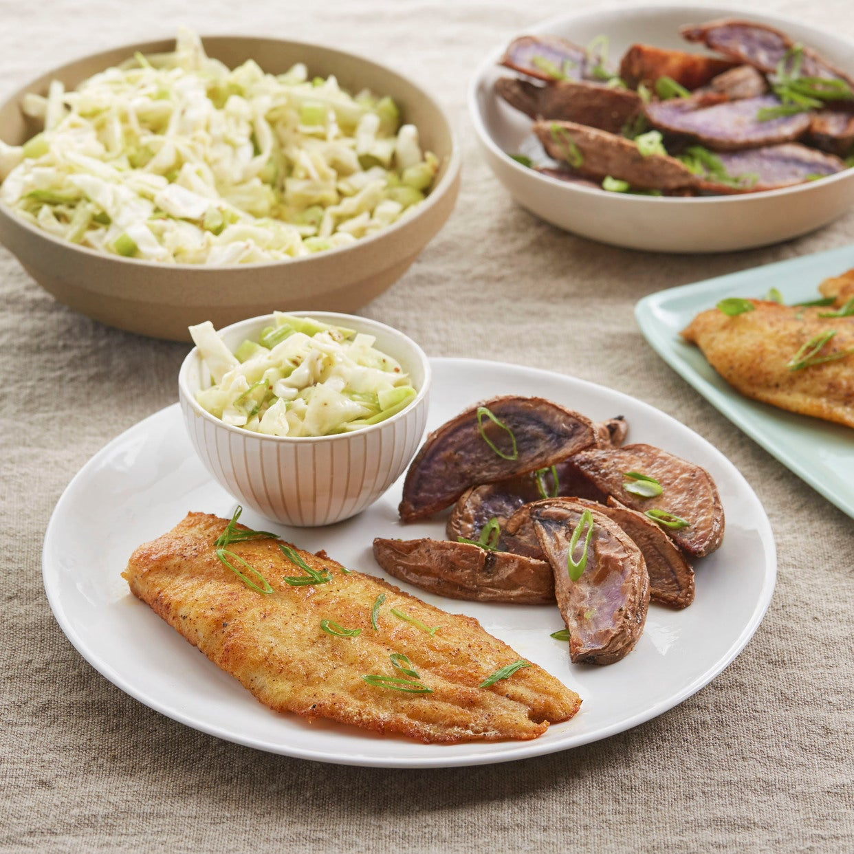 Paprika-Spiced Catfish with Cabbage Slaw & Roasted Purple Potato Wedges