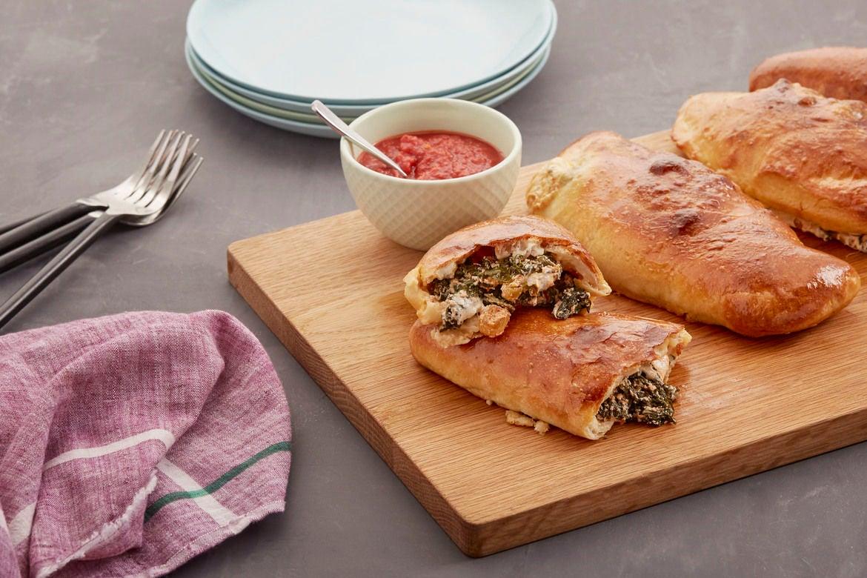 Mozzarella & Ricotta Calzones with Kale & Spicy Tomato Dipping Sauce