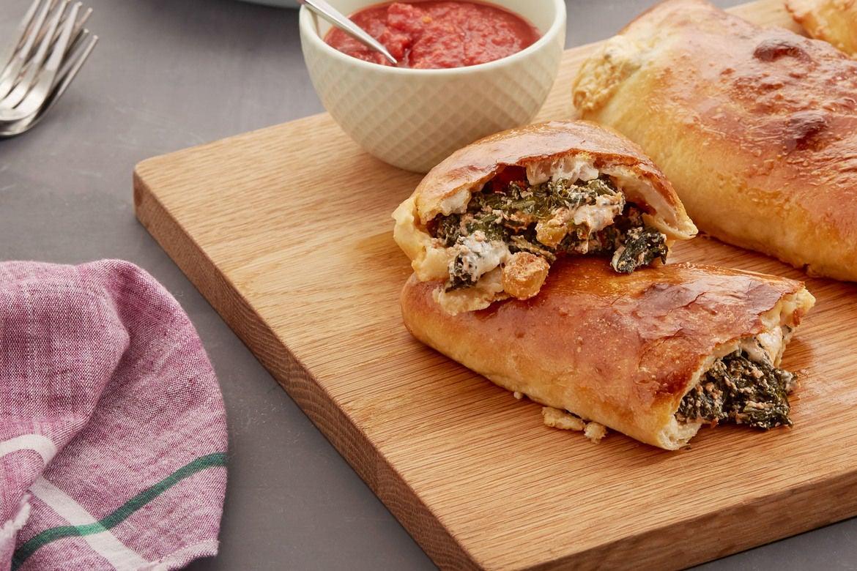 Mozzarella & Ricotta Calzones with Kale & Spicy Tomato Sauce