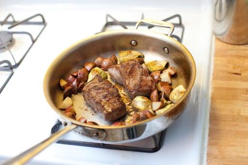Add the artichokes: