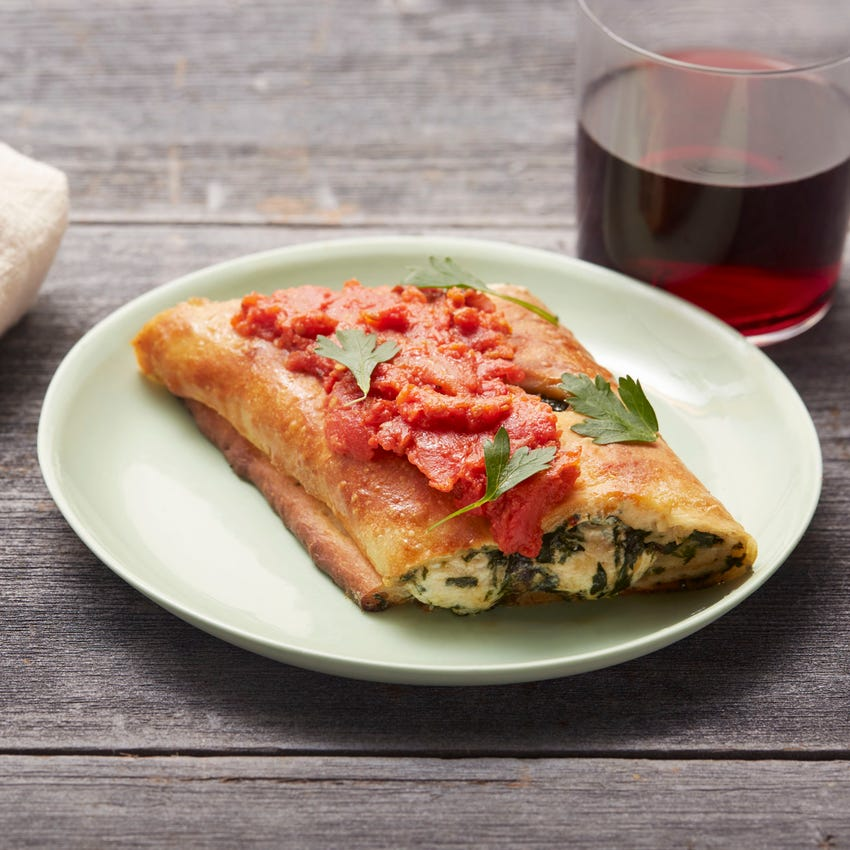 Mushroom & Spinach Stromboli with Fresh Mozzarella & Tomato Sauce