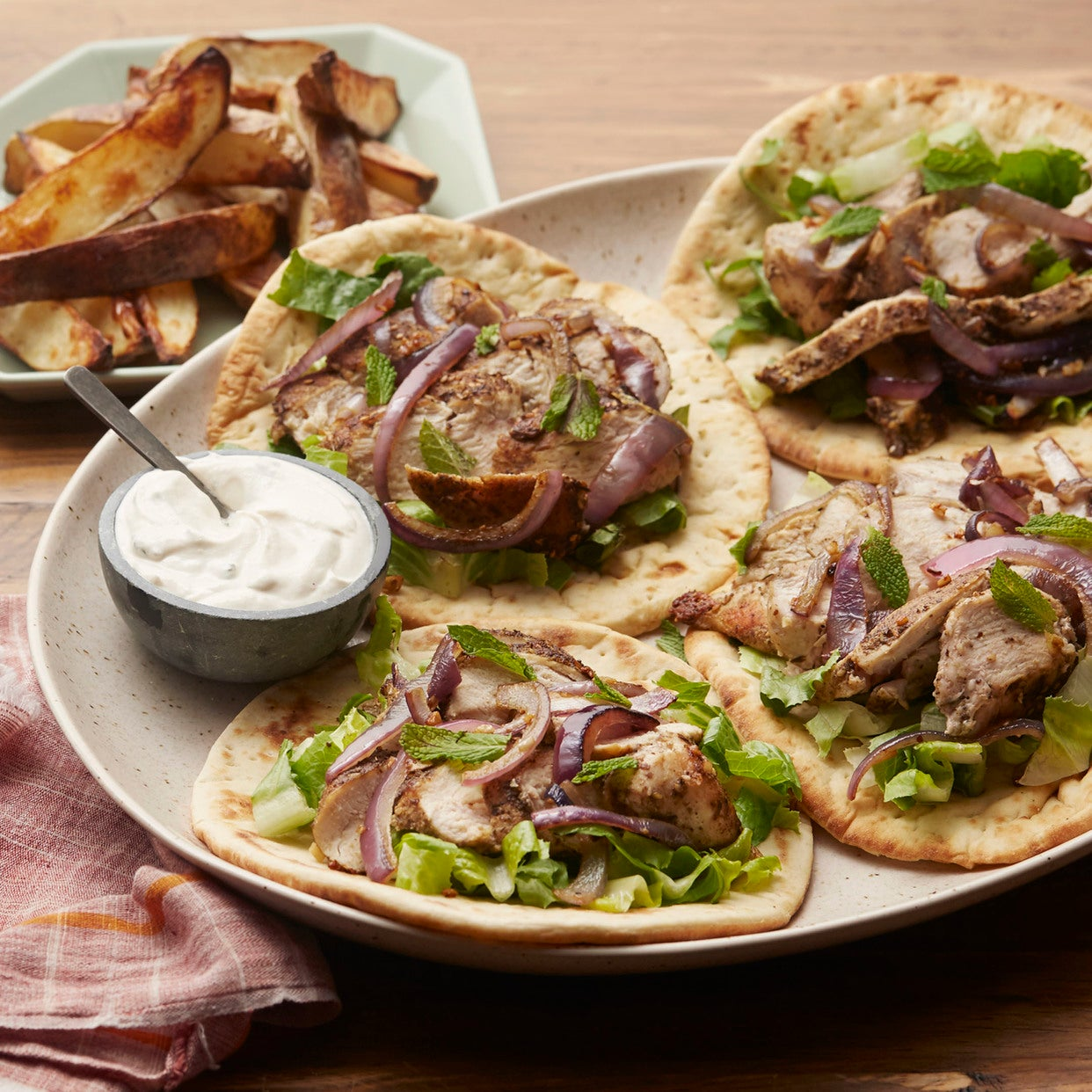 Za'atar Chicken Souvlaki with Tahini-Yogurt Sauce & Roasted Potatoes
