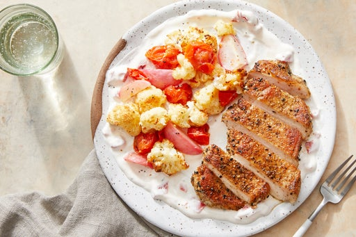 Dukkah-Spiced Pork Chops with Roasted Cauliflower, Radishes, & Tomatoes