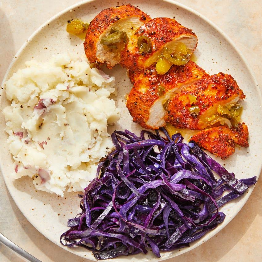 Roasted Chicken & Jalapeño-Orange Sauce with Sautéed Cabbage & Mashed Potatoes
