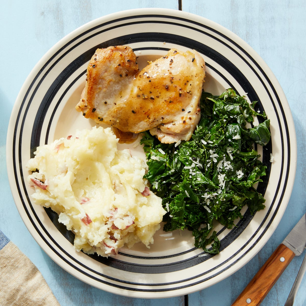 Seared Chicken Thighs & Lemon-Butter Sauce with Fontina Mashed Potatoes & Garlic Kale