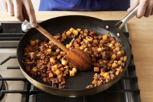 Add the ras el hanout & tomato paste: