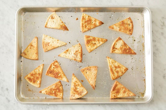 Make the pita chips & serve your dish: