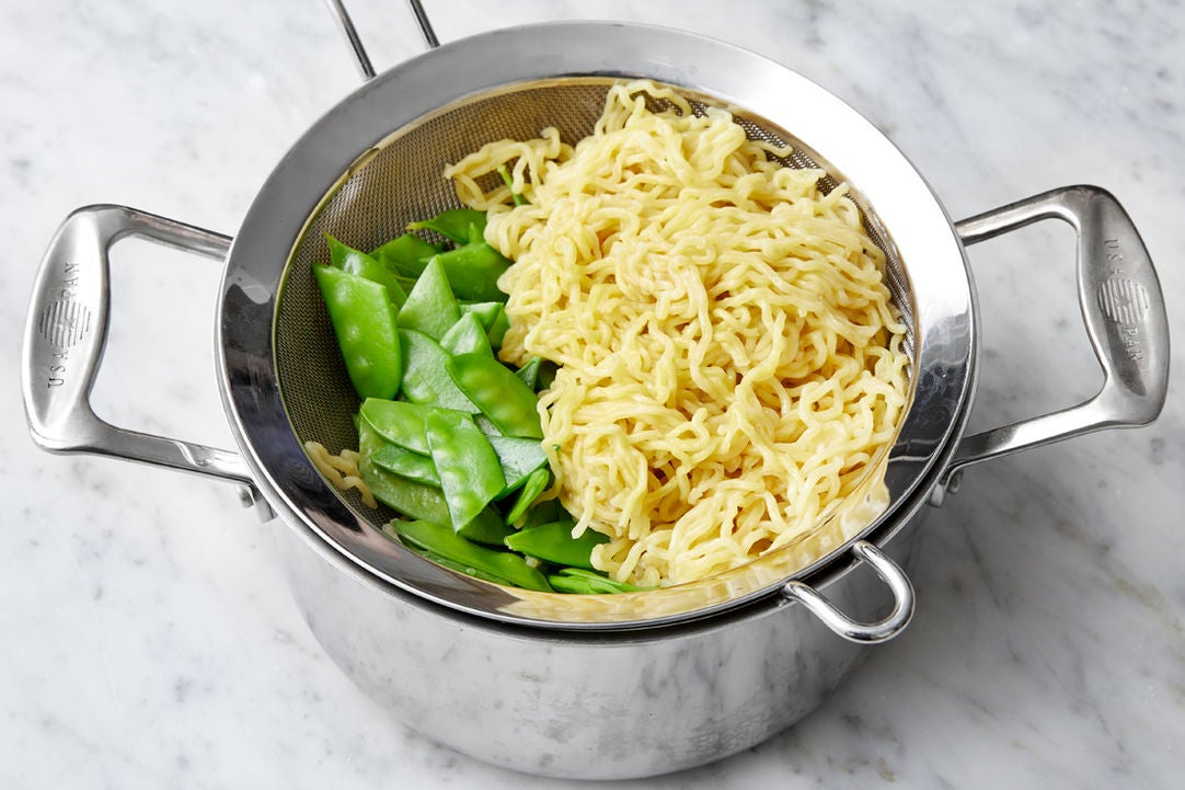 Cook the noodles & peas: