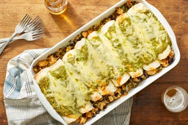 Chicken, Black Bean & Kale Enchiladas with Creamy Cilantro Sauce