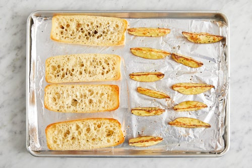 Toast the baguettes & finish the potatoes: