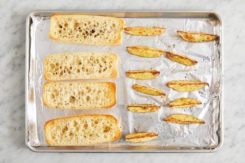 Toast the baguettes & finish the potatoes:
