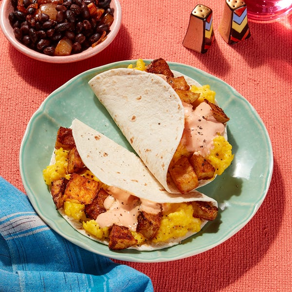 Austin-Style Breakfast Tacos with Cheesy Eggs, Roasted Potatoes & Spicy Sour Cream
