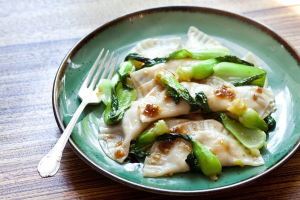 Tofu Ravioli with Glazed Baby Bok Choy Leaves
