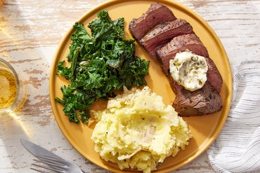 Seared Steaks  & Caper Butter with Mashed Potatoes  & Sautéed Kale