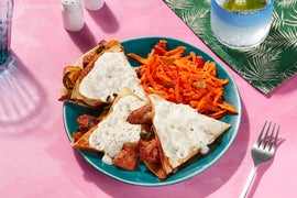 San Francisco-Style Smothered Chicken Quesadillas with Carrot Slaw