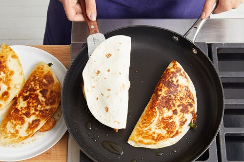 Cook the quesadillas & serve your dish: