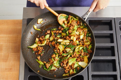 Add the bok choy & sauce: