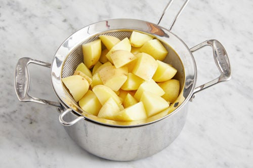 Cook the potatoes & make the potato salad: