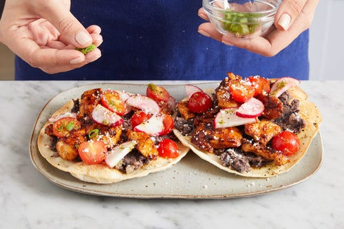 Assemble the tostadas & serve your dish: