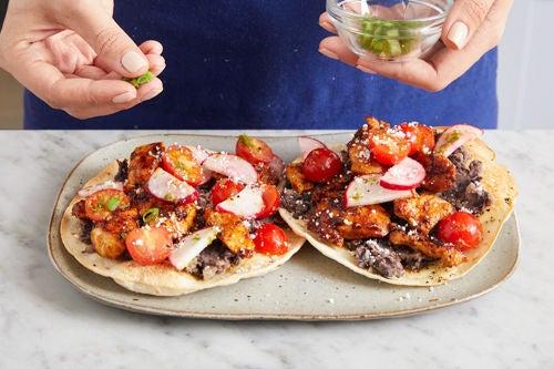 Assemble the tostadas & serve your dish: