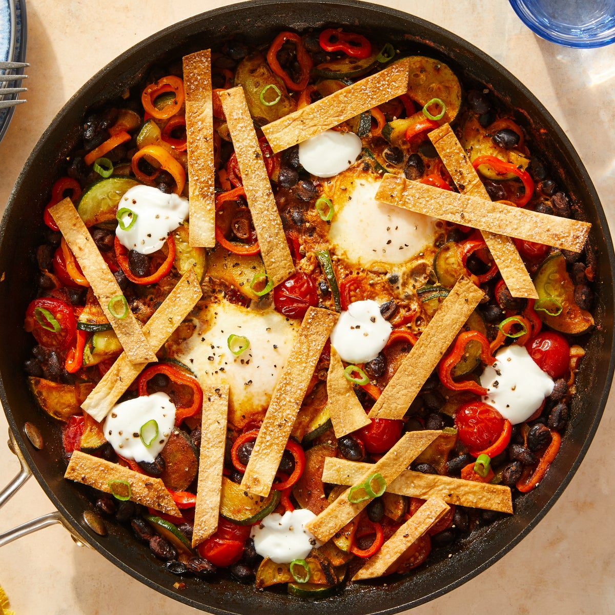 Smoky Black Bean & Vegetable Skillet with Eggs & Crispy Tortilla Strips