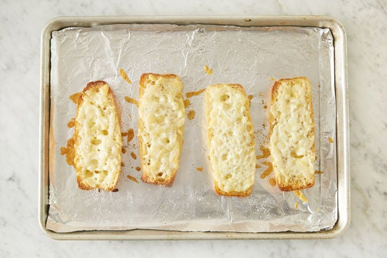 Make the cheesy garlic bread: