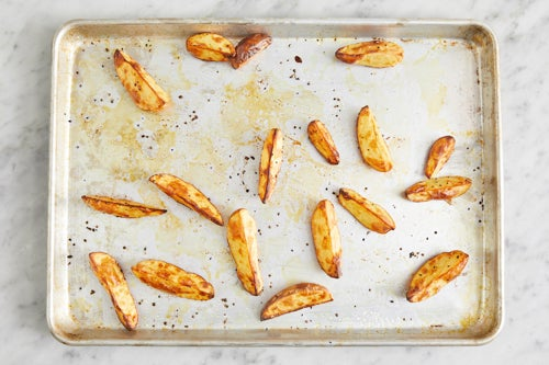 Prepare & roast the potatoes: