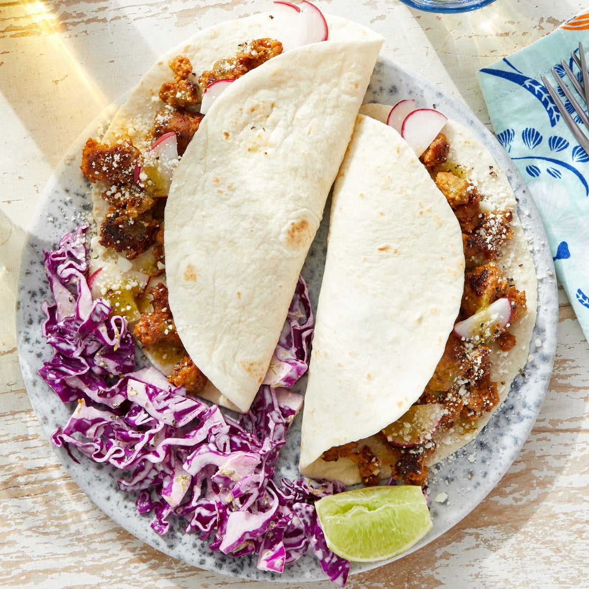 Tomatillo Pork Tacos with Cotija & Cabbage Slaw