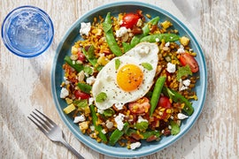 Peach & Snap Pea Grain Bowl with Goat Cheese & a Sunny Side-Up Egg
