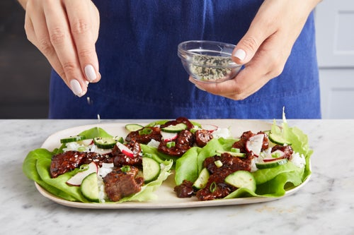 Assemble the lettuce cups & serve your dish: