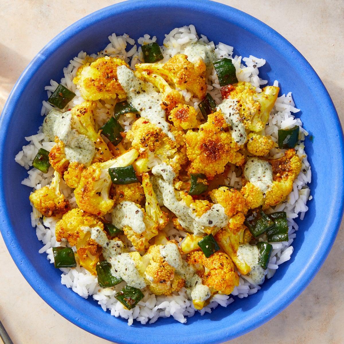 Curry-Roasted Cauliflower with Garlic Rice & Cilantro-Yogurt Sauce