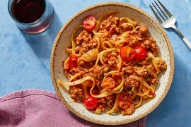 Fettuccine & Pork Ragù with Fresh Tomatoes  & Olives