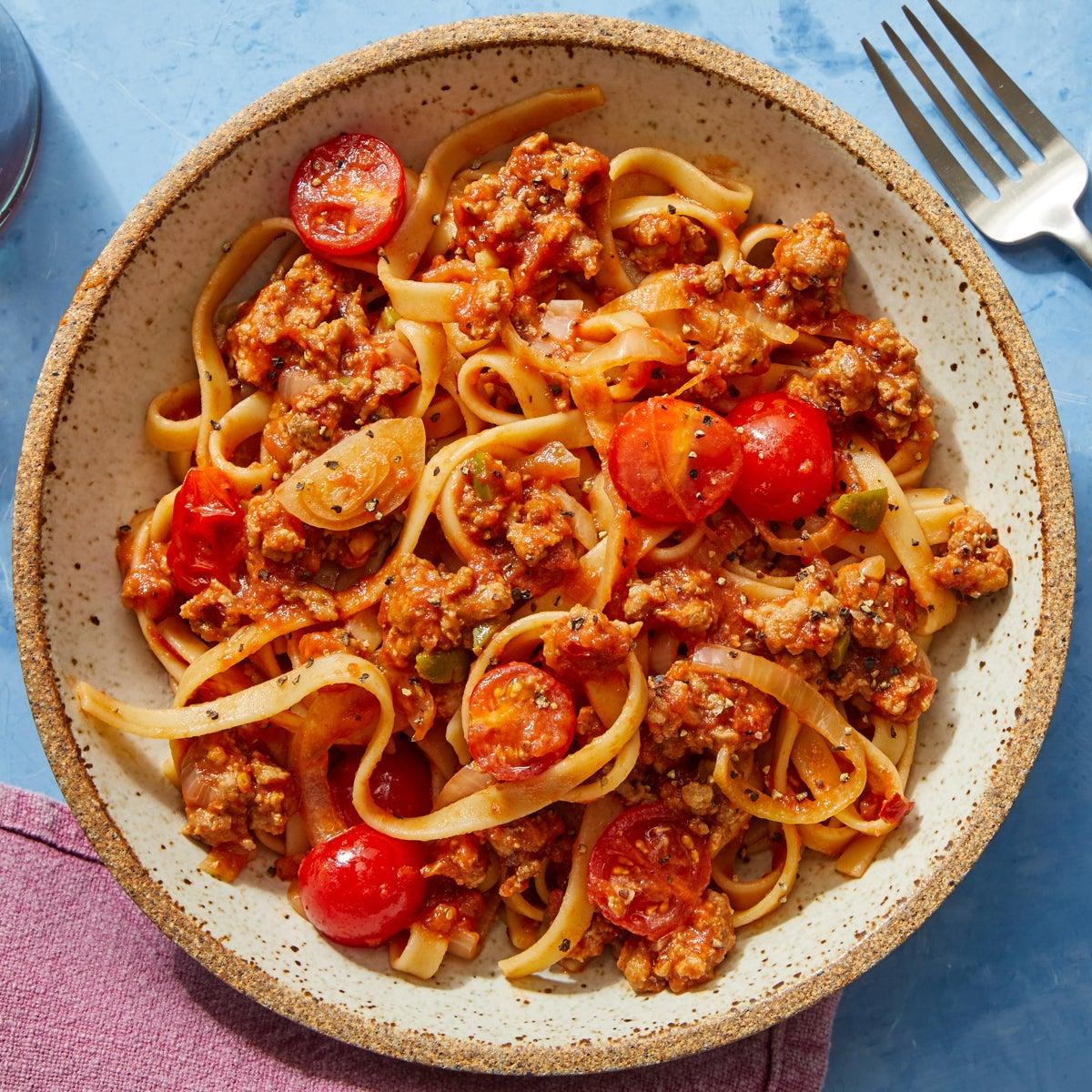 Fettuccine & Pork Ragù with Fresh Tomatoes  & Olives