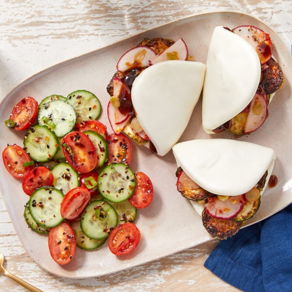 Crispy Zucchini &  Spicy Radish Bao with Cucumber-Tomato Salad