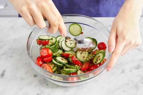 Make the cucumber-tomato salad: