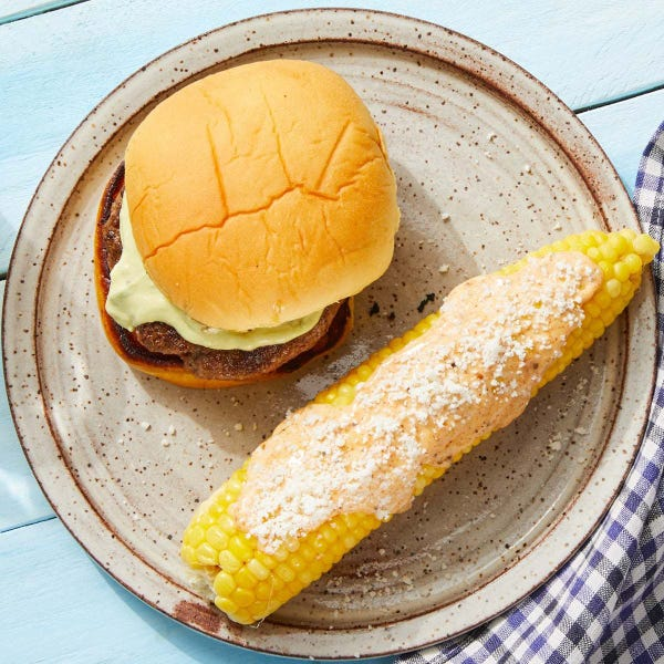 Creamy Guacamole Burgers with Elote-Style Corn on the Cob