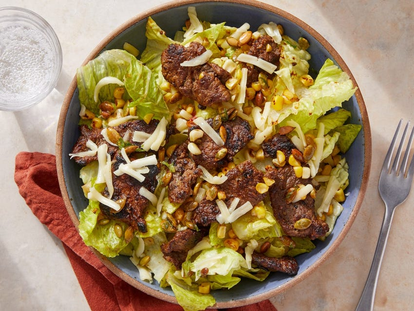 Chipotle Beef Taco Salad with Lime Pepitas, Corn & Guacamole Dressing