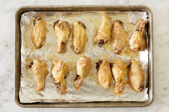 Roast the chicken wings: