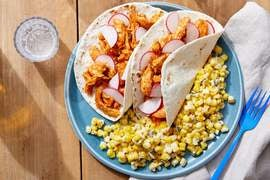 Shredded Guajillo Chicken Tacos with Spicy Corn Sauté