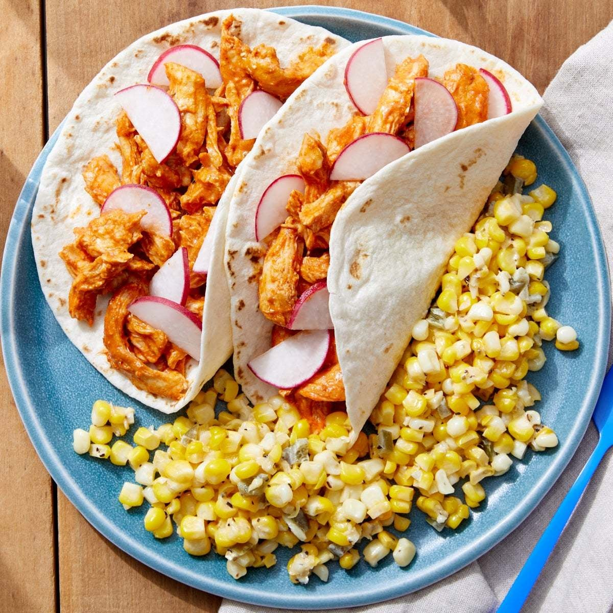 Shredded Guajillo Chicken Tacos with Spicy Corn Sauté