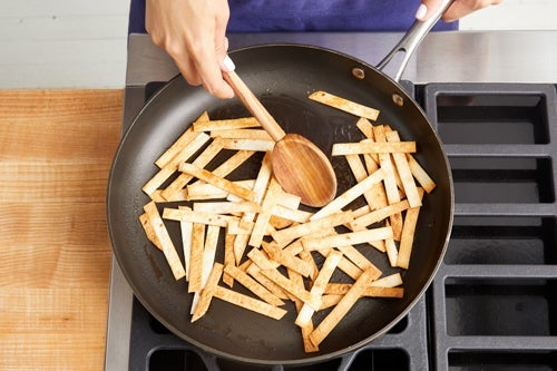 Make the crispy tortilla strips:
